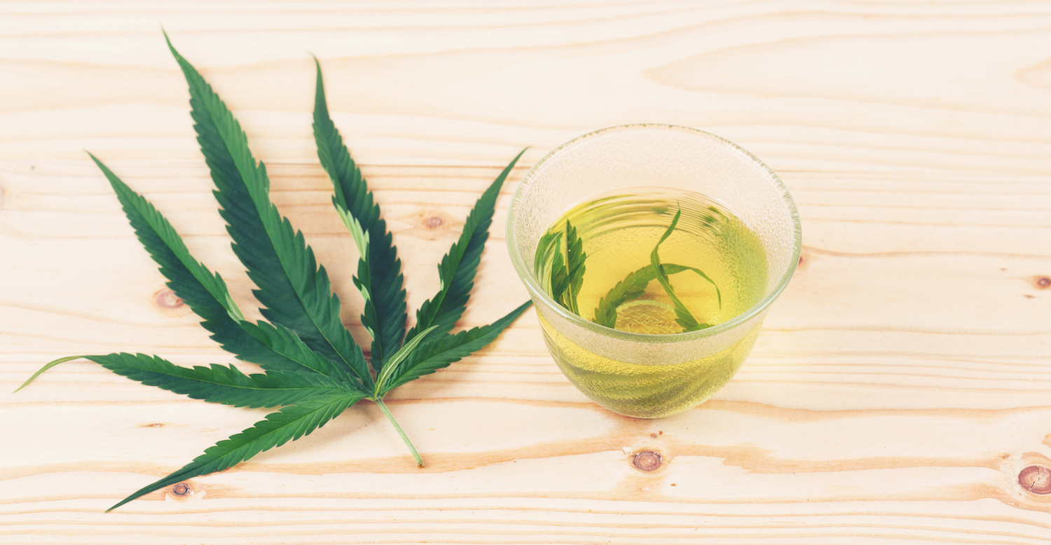 The benefits of cooking with Cannabis at Pure Life Wellness in Baltimore | marijuana herbal tea in glass teacup